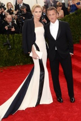 Charlize Theron in Christian Dior and Jimmy Choo with Sean Penn