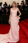 Taylor Swift in a custom-made gown by Oscar de la Renta